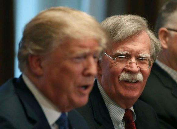 Reactions pour in after Trump dismissed his National Security Adviser John Bolton
