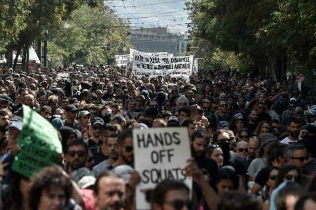 Greek police evict over 200 migrants from Athens squats