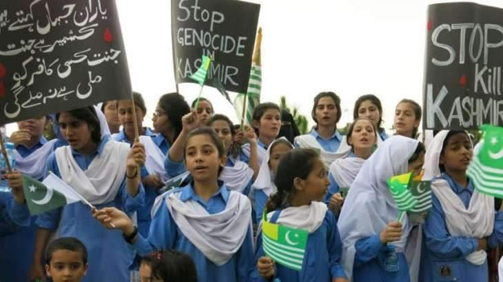 Female teachers, students stage rally to express solidarity with women of IOK