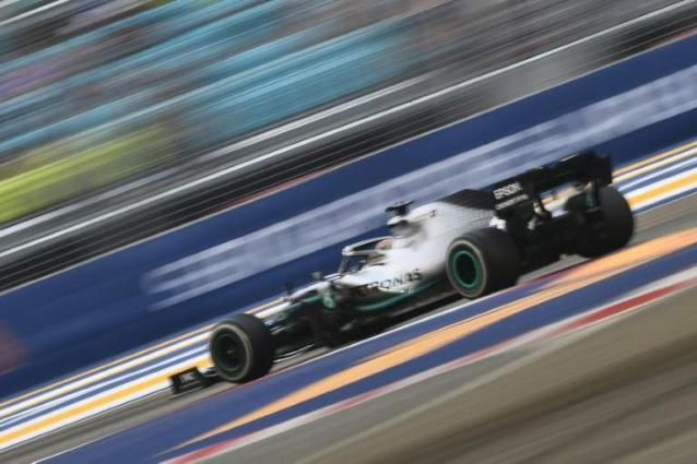 Hamilton shocked by Ferrari pace as Leclerc takes Singapore pole
