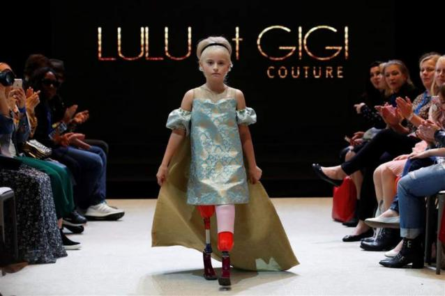 Double amputee girl aged 9 debuts on Paris fashion catwalk