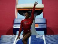 Biles wins record-equalling 23rd worlds medal, misses out on unev ..