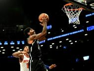 Irving, Nets hold off Knicks in Big Apple NBA battle, Lakers win