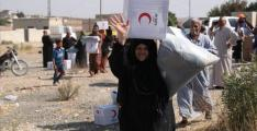 Turkish Red Crescent Delivers Aid to Residents of Syrian Tal Abyad Affected by Hostilities