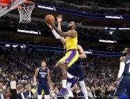 James powers Lakers to overtime win against Mavs