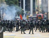 Hong Kong Police Fire Tear Gas at Protesters Near Polytechnic Uni ..