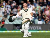 Warner hits 335, Smith shatters record as Pakistan suffer