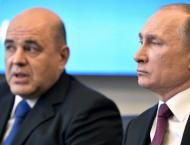 Putin's new prime minister promises 'real changes' for Russians