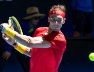 Nadal aims to keep heat on Federer Slams record
