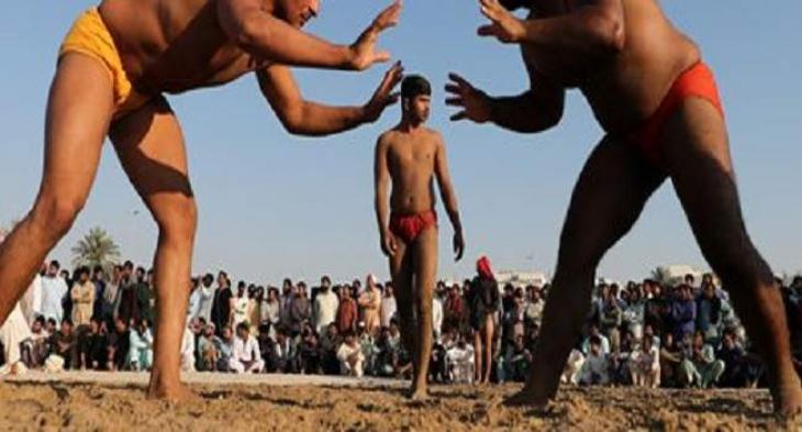 Traditional wrestlers demonstrate skills