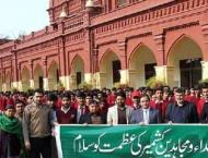 Government College University students form human chain to expres ..