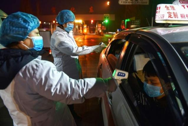 China virus death toll nears 1,400, six health workers among victims
