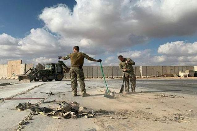 U.S. squeezes Iraq with cash delays, short waivers