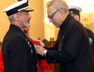 President of Pakistan Dr Arif Alvi confers military awards to of ..