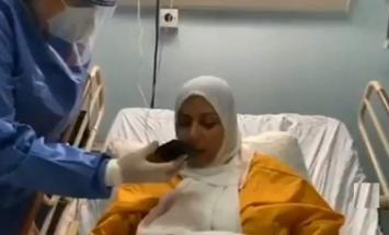 ملک الأردن و عقیلتہ یھاتفان بسیدة مصابة ..