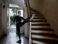 In virus lockdown, Moulin Rouge dancers go through their paces