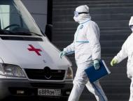 Russia reports record virus death toll