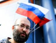 'One-man picket' lands Russian journalist in jail for 15 days