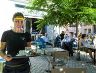 French reclaim cafes as virus hammers Latin America