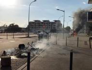 France arrests five Chechens in raids after unrest