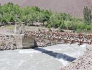 Work on dilapidated old bridge on River Chitral begins