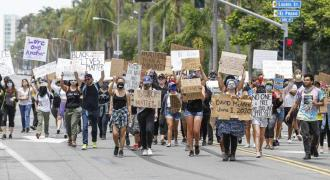 US protests head into second week over killing of African-American man amid emerging police reforms ..