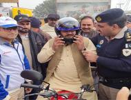 Motorway Police distribute free helmets among motorcyclists