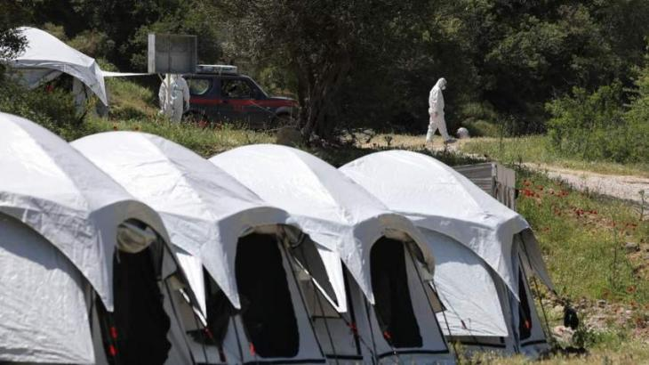 Greek migrant camp virus lockdown extended by a month