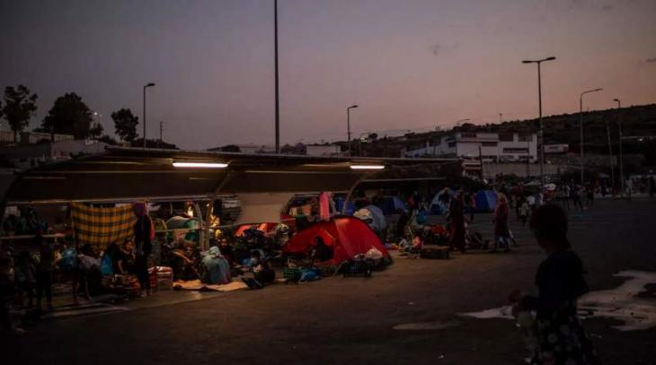 Lesbos police begin operation to move homeless migrants to new camp
