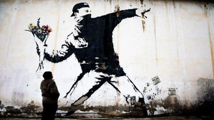 Banksy loses trademark case over the 'Flower Thrower'