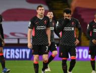 Liverpool, Man Utd lick wounds after humbling Premier League defe ..
