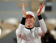 Fired up by Guns N'Roses, Swiatek rocking through Roland Garros