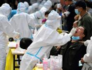 China tests entire city for virus as Europe tightens controls