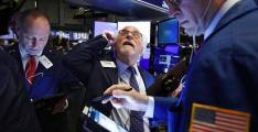 Dow, Nasdaq drop 3%, sliding further on Covid-19 fears