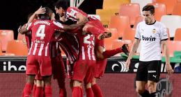 Atletico beat Valencia to move level with leaders Sociedad