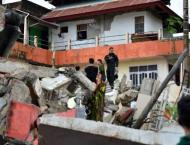 Powerful Indonesia quake kills at least 34, topples buildings