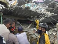 Powerful Indonesia quake kills at least 37, topples buildings