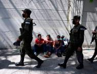 12 policemen arrested in deaths of burned migrants near US-Mexico ..