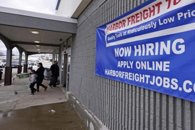 US jobless claims fall, but remain high