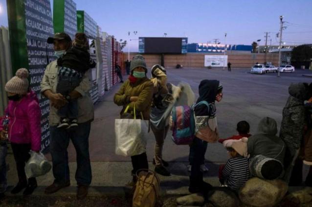 Migrants on US-Mexican border pray Biden opens door
