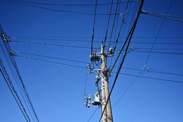 Chinese man causes outage after sit-ups atop power pole: reports
