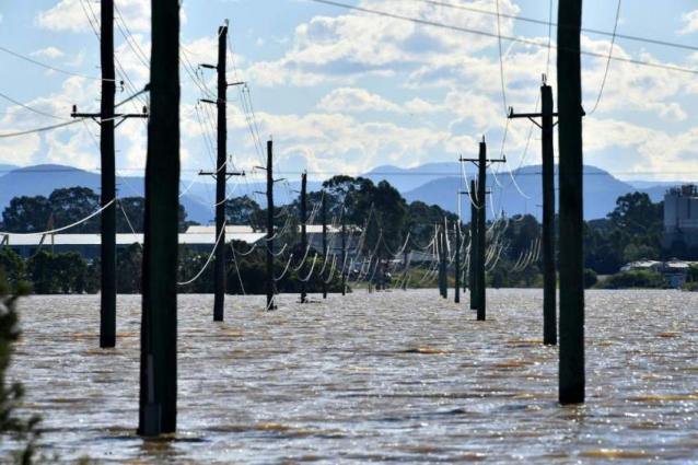 Some Australians return home as others evacuated in floods crisis