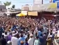 Protesters gather outside Laal Haveli in Rawalpindi