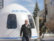 Bezos' Blue Origin Opens Bidding for Seat on First Space Tourism  ..
