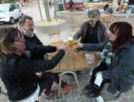 Belgians brave rain to return to outdoor tables