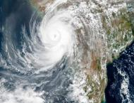 24 dead, dozens missing as cyclone batters Covid-stricken India