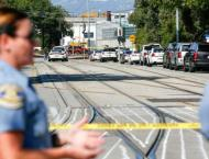 Nine killed by employee in California rail yard mass shooting