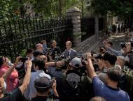 China holds spy trial of Australian writer behind closed doors