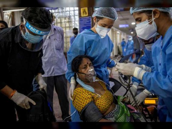 India's daily COVID-19 cases rise by record 414,188