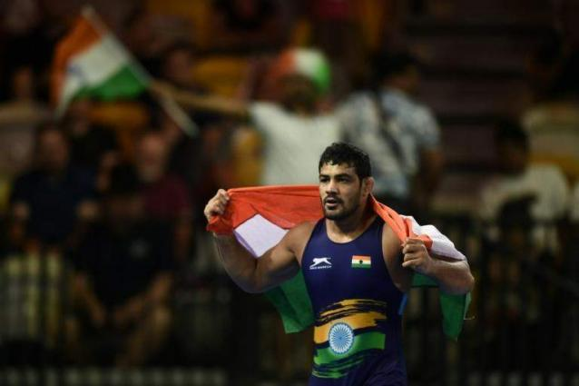 India offers reward for Olympic medalist wanted in murder case